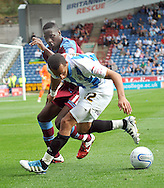Picture by Graham Crowther/Focus Images Ltd. 07763140036.10/9/11 .Anton Robinson of Huddersfield  battles for the ball with Lucas Akins of Tranmere during the Npower League 1 game at the Galpharm Stadium, Huddersfield.