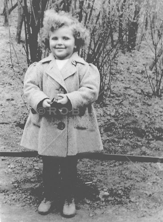snapshot from the 1930's of a pretty little girl outdoors