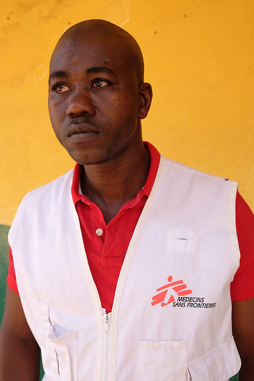MSF patient support officer Tidiane -- at the MSF mobile clinic in the neighbourhood of Tombolia, Conakry, Guinea on March 18, 2016. MSF launched a HIV testing campaign in Conakry with the support of health authorities moving throughout several neighbourhoods throughout 2016.<br /> <br /> The reason that we decided to organise a mass awareness and screening campaign for HIV AIDS was to allow the population to have access to information and also treatment. The level of understanding of HIV AIDS in Guinea is generally very very low. We are in a country where the perceptions of HIV AIDS are negative, the population is scared of contracting the illness because they believe to have HIV AIDS signifies death. In general Guinea does not have easy access to HIV AIDS screening and testing. Since the last few years screenings are rare and where you can be tested you need to pay. We decided to undertake the mass campaign now because in the fight against ebola we trained an important number of community health promoters so with the end of the ebola epidemic we wanted to use the human resource for informing the population on HIV SIDA. Our strategy for encouraging people to be tested is by working alongside people in the community living with HIV AIDS and activists. These activists give their testimonies to the population so they will understand it&rsquo;s possible to live with HIV and be healthy.&quot;<br /> <br /> &quot;Despite countries in West and Central Africa having a relatively low HIV prevalence (