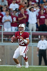 September 19, 2009; Stanford, CA, USA;  Stanford Cardinal quarterback Andrew Luck (12) stands in the pocket during the first quarter against the San Jose State Spartans at Stanford Stadium. Stanford defeated San Jose State 42-17. Mandatory Credit: Jason O. Watson-US PRESSWIRE