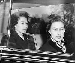 File photo dated 05/05/1952 of Queen Elizabeth II with Princess Margaret returning to London from Windsor, as Winston Churchill's 1950s Conservative government raised the allowance for royal princesses because they were no longer able to find wealthy husbands to support them, newly released files reveal.