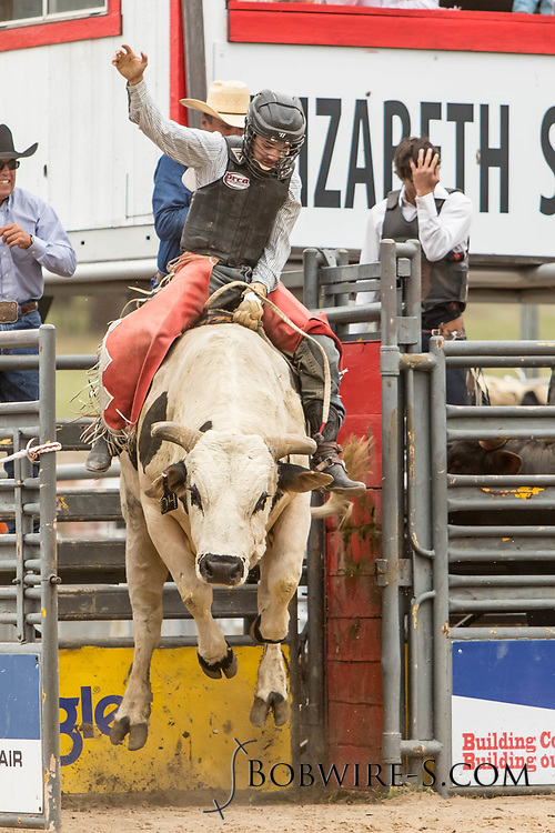 Bull rider Wyatt Joseph rides Summit Pro Rodeo's Suit N Tie during the third performance of the Elizabeth Stampede on Sunday, June 3, 2018.