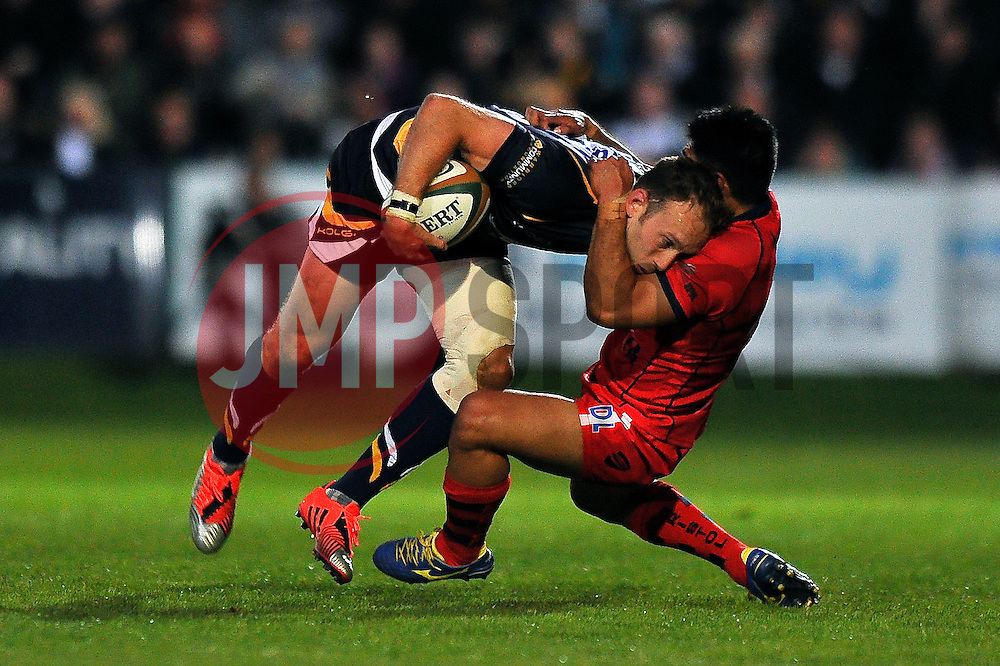 Chris Pennell of Worcester Warriors is tackled by David Lemi of Bristol Rugby - Photo mandatory by-line: Patrick Khachfe/JMP - Mobile: 07966 386802 27/05/2015 - SPORT - RUGBY UNION - Worcester - Sixways Stadium - Worcester Warriors v Bristol Rugby - Greene King IPA Championship Play-off Final (Second leg)