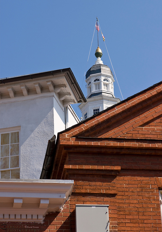 Annapolis, Maryland--The dome of the Maryland State house is seen in this view, between two buildings on Main Street. The Maryland State House is the oldest state house still in legislative use. It was designated a National Historic Landmark in 1960.