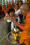 Villagers give the local monks a water blessing during the 2nd day of Songkran 2017 in Nakhon Nayok, Thailand. PHOTO BY LEE CRAKER