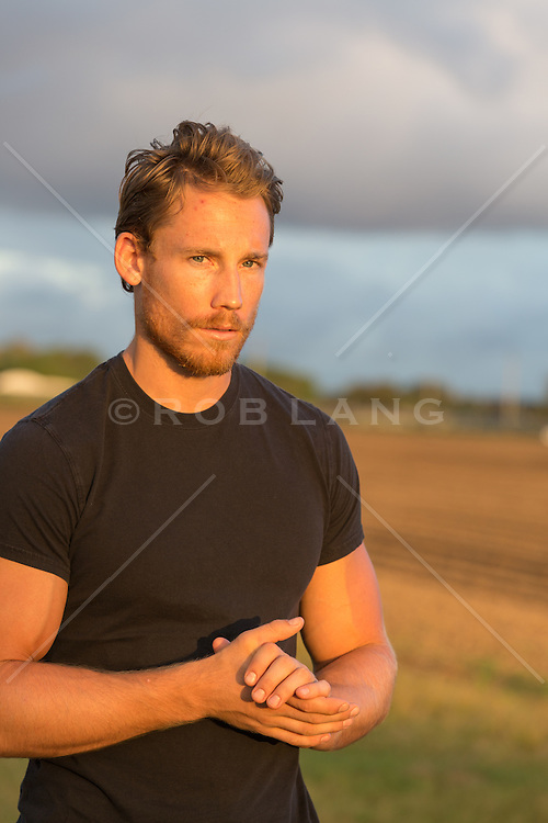 sexy man with a beard outdoors