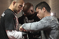 MANCHESTER, ENGLAND, NOVEMBER 11, 2009: Brandon Vera has his boxing glove laced up at the open work-outs for UFC 105 at the Crowne Plaza Hotel in Manchester, England on November 11, 2009.