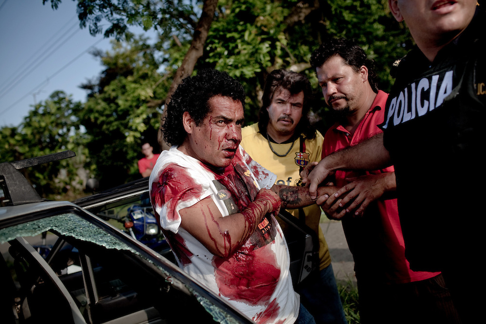 A man is taken out of the car after he was shot by a group of young men in Limon, Costa Rica, March 6, 2011. He survived, but the reason for the attack is unclear. Limon is becoming extremely violent since a couple of years ago when drug cartels are operating in the city, an important route of the drug going to the north. In the past decades drug dealers were paying money to the people involved in drug trafficking, but since few years ago the payment is in drugs, making the population addict. Drug related killings are becoming more and more common, as well as violence in general. Photo/Tomas Munita
