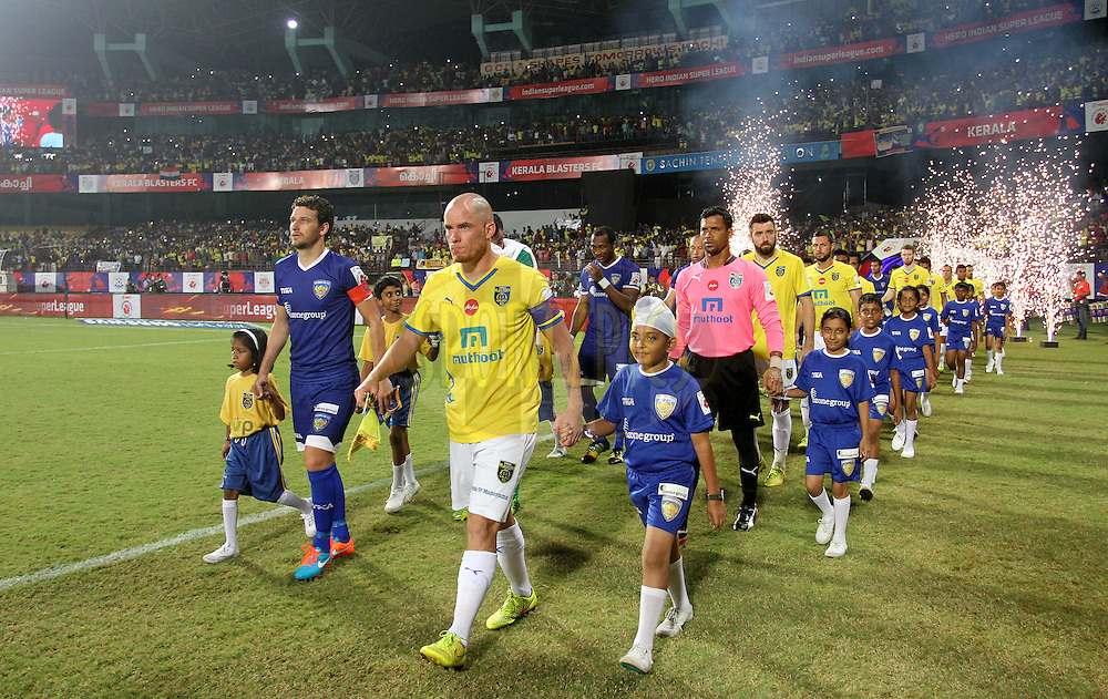 Kerala Blasters FC and Chennaiyin FC players arrive on the ground for the 1st Semi Final match of the Hero Indian Super League between Kerala Blasters FC and Chennaiyin FC held at the Jawaharlal Nehru Stadium, Kochi, India on the 13th December 2014.<br /> <br /> Photo by:  Vipin Pawar/ ISL/ SPORTZPICS