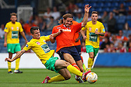 Luke Rooney of Luton Town (right) is tackled during the Pre Season Friendly match at Kenilworth Road, Luton<br /> Picture by David Horn/Focus Images Ltd +44 7545 970036<br /> 26/07/2014
