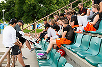 KELOWNA, BC - MAY 10:  Okanagan Sun head coach Jamie Boreham sits with players and goes over strategy during main camp at the Apple Bowl on July 12, 2019 in Kelowna, Canada. (Photo by Marissa Baecker/Shoot the Breeze)