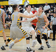 Archbishop Wood's Andrew Funk (14) drives towards the basket as Central Bucks West's Bill Power (3) and Ben Riegel (4) defend in the second quarter Saturday December 12, 2015 at Archbishop Wood in Warminster, Pennsylvania. (Photo by William Thomas Cain)