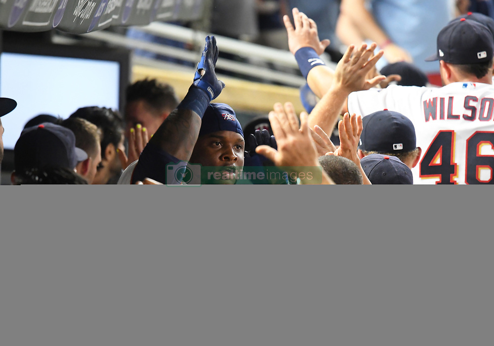 May 31, 2018 - Minneapolis, MN, U.S. - MINNEAPOLIS, MN - MAY 31: Minnesota Twins Third base Miguel Sano (22) is congratulated by teammates after hitting a 3-run home run in the bottom of the 7th during a MLB game between the Minnesota Twins and Cleveland Indians on May 31, 2018 at Target Field in Minneapolis, MN. The Indians defeated the Twins 9-8.(Photo by Nick Wosika/Icon Sportswire) (Credit Image: © Nick Wosika/Icon SMI via ZUMA Press)