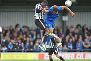Donervon Daniels wins a header during the EFL Sky Bet League 1 match between AFC Wimbledon and Rochdale at the Cherry Red Records Stadium, Kingston, England on 30 September 2017. Photo by Daniel Youngs.
