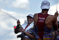 JEROME A. POLLOS/Press..Victor Zyemtsev, of the Ukraine, pops the cork on a champagne bottle as he celebrates his Ironman victory with Michael Lovato, of Boulder, Colo.