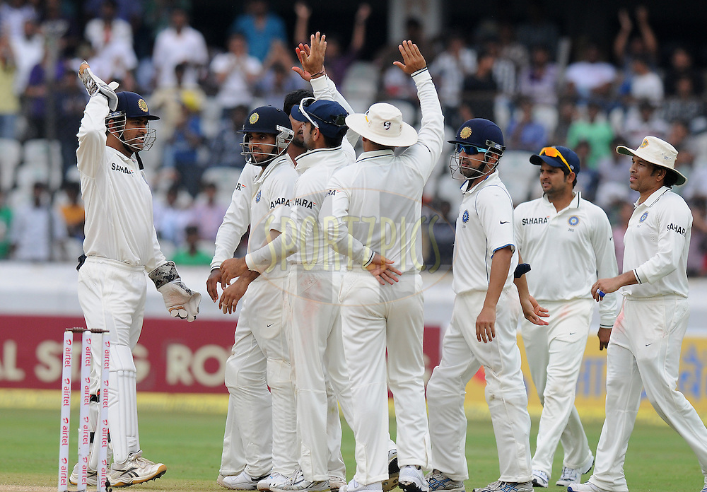 Pragyan Ojha of India celebrates the wicket of Doug Bracewell of New Zealand  during day four of the first test match between India and New Zealand held at The Rajiv Gandhi International Stadium in Hyderabad, India on the 26th August 2012..Photo by: Pal Pillai/BCCI/SPORTZPICS