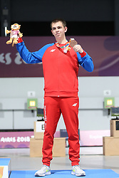 BUENOS AIRES, Oct. 8, 2018  Bronze medalist Aleksa Mitrovic of Serbia poses for photos during the awarding ceremony of the Men's 10m Air Rifle Final at the 2018 Summer Youth Olympic Games in Buenos Aires, capital of Argentina, Oct. 7, 2018. (Credit Image: © Li Ming/Xinhua via ZUMA Wire)