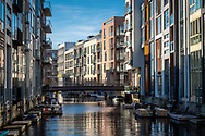 The Venice-like apartments of Sydhavnen in Copenhagen rise out of the water, with boats and canoes right by their door