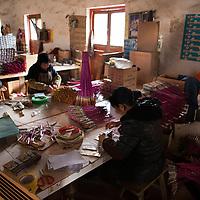 Hunan, Liuyang, Dec. 19..2013 :  rural women assemble firecrackers in a factory that produces firecrakcers for the Western market.