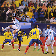 Ezequiel Garay, Argentina, wins a header from Felipe Caicedo, Ecuador, during the Argentina Vs Ecuador International friendly football match at MetLife Stadium, New Jersey. USA. 31st march 2015. Photo Tim Clayton