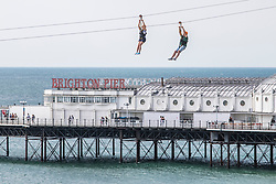 © Licensed to London News Pictures. 19/09/2020. Brighton, UK. Members of the public take a ride on the Zip Wire attraction on the beach in Brighton and Hove. Photo credit: Hugo Michiels/LNP