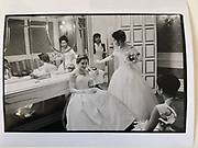 Maria Paterno Castello di San Giuliano, Princess Asaea Beatrice Reyna di Savoia, Miss Hikari Ohta in the ladies powder room during the International Debutante Ball. Plaza Hotel. New York. 29 December 1993. Film. 93234f33<br /> <br /> © Copyright Photograph by Dafydd Jones<br /> 66 Stockwell Park Rd. London SW9 0DA<br /> Tel 0171 733 0108