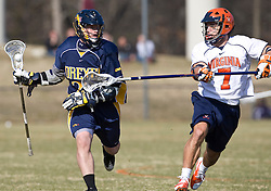 Drexel Dragson M Ryan West (22) is defended by Virginia Cavaliers D Chad Gaudet (7).  The #2 ranked Virginia Cavaliers defeated the Drexel Dragons 13-7 at the University of Virginia's Klockner Stadium in Charlottesville, VA on February 14, 2009.