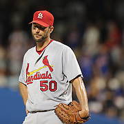 NEW YORK, NEW YORK - July 27: Pitcher Adam Wainwright #50 of the St. Louis Cardinals after Yoenis Cespedes #52 of the New York Mets hit a two run home run off him during the St. Louis Cardinals Vs New York Mets regular season MLB game at Citi Field on July 27, 2016 in New York City. (Photo by Tim Clayton/Corbis via Getty Images)