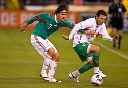 February 24, 2010; San Francisco, CA, USA;  Bolivia defender Nicolas Suarez (16) is defended by Mexico midfielder Braulio Luna (7) during the first half at Candlestick Park.  Mexico defeate Bolivia 5-0.