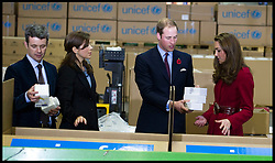 Prince William and Kate with the Crown Prince Frederik and his wife Mary help pack boxes at the UNICEF Supply Division Copehagen. The Royal family's were helping to distribute emergency food and medical supplies to East East AfricaBritish and Danish Royal Family's meeting for the first time..Prince William and Kate with the Crown Prince Frederik and his wife Mary at the UNICEF Supply Division Copehagen. The Royal family's were helping to distribute emergency food and medical supplies to East Africa, Wednesday November 2, 2011. Photo By i-Images