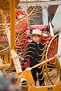 Amish boy views farm equipment during the Annual Mud Sale to support the Fire Department  in Gordonville, PA.