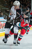 KELOWNA, CANADA - NOVEMBER 18: Jake Kryski #14 of the Kelowna Rockets back checks Thomas Foster #16 of the Vancouver Giants during second period on November 18, 2016 at Prospera Place in Kelowna, British Columbia, Canada.  (Photo by Marissa Baecker/Shoot the Breeze)  *** Local Caption *** Jake Kryski; Thomas Foster;