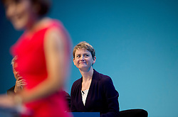 © London News Pictures. 22/09/2013 . Brighton, UK.  Shadow Minister for Women and Equalities, Yvette Cooper (Centre) listening to a speaker on Day one of the 2013 Labour Party Annual Conference in Brighton, East Sussex. Photo credit : Ben Cawthra/LNP