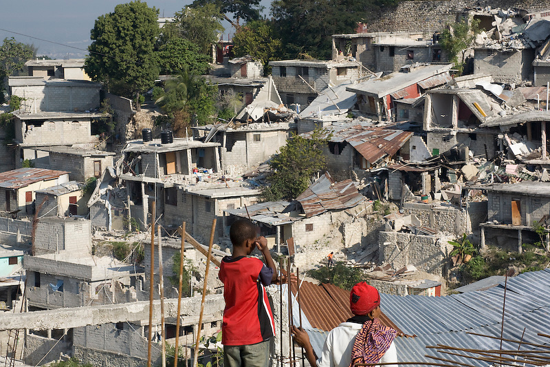 People try to recover thier belongings from collapsed homes in Nerettes, Petionville, Haiti. Photo by Ben Depp.1/20/2010.