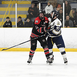 TORONTO, ON  - APR 10,  2018: Ontario Junior Hockey League, South West Conference Championship Series. Game seven of the best of seven series between Georgetown Raiders and the Toronto Patriots. Matt McJannet #12 of the Georgetown Raiders battles for position with Nick Kalpousos #77 of the Toronto Patriots during the second period.<br /> (Photo by Andy Corneau / OJHL Images)