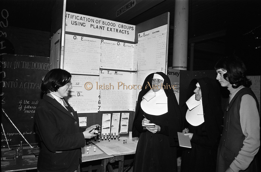 """04/01/1967.01/04/1967.4th January 1967 .The third annual Aer Lingus Young Scientist Exhibition at the RDS..Picture shows Eileen Mary Dillon (on left of picture) from the Convent of Mercy, Spanish Point, Co. Clare, explaining her exhibit """"The identification of blood groups using plant(seed) extracts"""" to (L-R) Sr. Arangelists, Sr. Magdelene (both from St Marys Convent, Arklow) and Bernadette Flynn from Spanish Point. Eileen Dillion was joint first prize winner in the junior biochemistry section. ."""