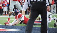 Ole Miss Rebels quarterback Bo Wallace (14) scores against Mississippi State at Vaught-Hemingway Stadium in Oxford, Miss. on Saturday, November 29, 2014. Ole Miss won 31-17.