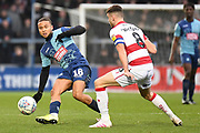 Wycombe Wanderers midfielder Curtis Thompson(18) looks to release the ball  under pressure from Doncaster Rovers midfielder Ben Whiteman (8) during the EFL Sky Bet League 1 match between Wycombe Wanderers and Doncaster Rovers at Adams Park, High Wycombe, England on 23 November 2019.