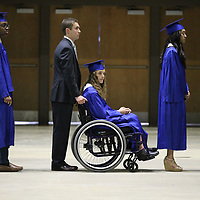 Emmalee Blaylock has to have a little help getting her wheelchair up the ramp after she broke her leg just a few days before graduation.