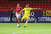 AFC Wimbledon midfielder Anthony Hartigan (8) with a shot on goal during the EFL Trophy match between Charlton Athletic and AFC Wimbledon at The Valley, London, England on 4 September 2018.