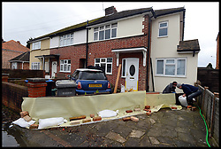 Residents in Egham start building flood defences outside their home as floods hit the town, United Kingdom, Wednesday, 12th February 2014. Picture by Andrew Parsons / i-Images