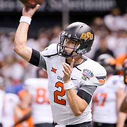 Jan 1, 2016; New Orleans, LA, USA; Oklahoma State Cowboys quarterback Mason Rudolph (2) throws in warm ups prior to kickoff in the 2016 Sugar Bowl against the Mississippi Rebels at the Mercedes-Benz Superdome. Mandatory Credit: Derick E. Hingle-USA TODAY Sports