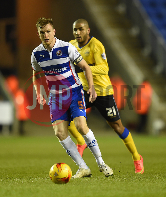 Reading captain Alex Pearce in action during the Sky Bet Championship match between Reading and Wigan Athletic at Madejski Stadium on 17 February 2015 in Reading, England - Photo mandatory by-line: Paul Knight/JMP - Mobile: 07966 386802 - 17/02/2015 - SPORT - Football - Reading - Madejski Stadium - Reading v Wigan Athletic - Sky Bet Championship