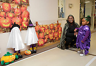 Middletown, New York - A woman adjusts a child's costume at the Family Fall Festival at the Middletown YMCA on Oct. 23, 2010. ©Tom Bushey / The Image Works