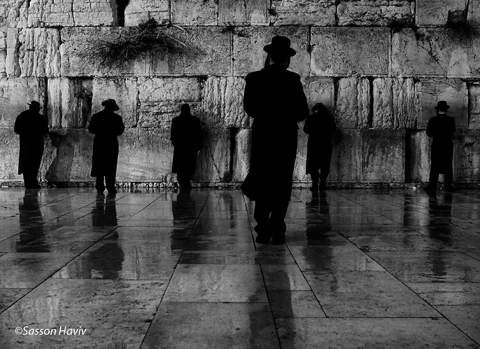 Six orthodox Jewish men praying at the Wailing wall, Jerusalem, Israel.