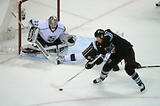 May 26, 2013; San Jose, CA, USA; Los Angeles Kings goalie Jonathan Quick (32) defends the net against San Jose Sharks center Joe Pavelski (8) during the first period in game six of the second round of the 2013 Stanley Cup Playoffs at HP Pavilion.