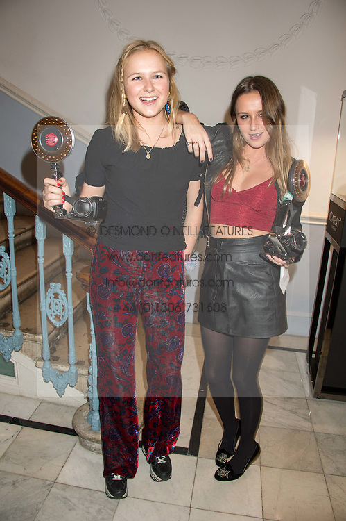 Left to right, sisters KITTY JENKS and DAISY JENKS at the Tatler Little Black Book Party at Home House Member's Club, Portman Square, London supported by CARAT on 11th November 2015.