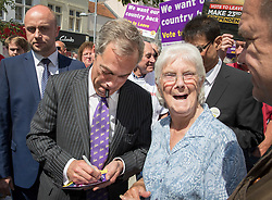 © Licensed to London News Pictures. 20/06/2016. Clacton-on-Sea, UK . UKIP party leader Nigel Farage signs an autograph as he meets with supporters during campaigning for Brexit in the last few days of the EU referendum. Photo credit: Peter Macdiarmid/LNP