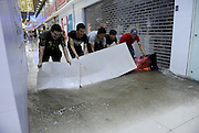 BEIJING, CHINA - JULY 20: <br /> <br />  People block floodwater at underground business stores on July 20, 2016 in Tianjin, China. Tianjin Meteorological Observatory has issued an orange alert to heavy rainfall at 08:07 am early Wednesday and the rainstorm is predicted to continue in following six hours.<br /> ©Exclusivepix Media