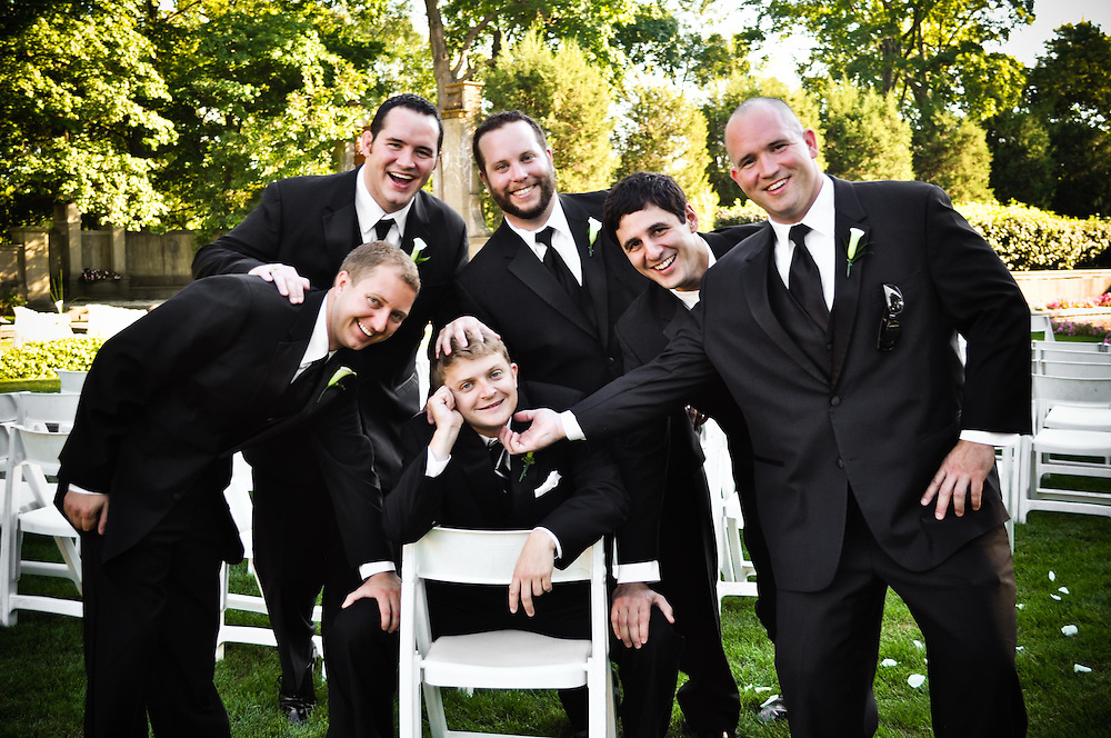 Craig's groomsmen lay hands on him for good luck at The Armour House, Lake Forest, IL